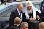 Путин попросил Патриарха помочь Украине обрести мир