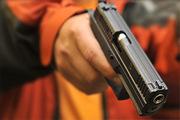 Американец расстрелял компьютер из пистолета за то, что тот медленно работал