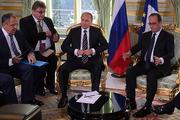 Путин в Париже поговорил с Олландом и Меркель