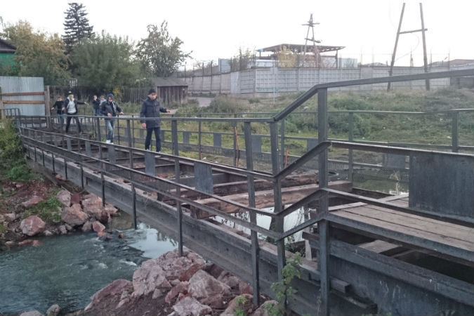 сдали мост через Бугач