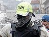 Гаитянский полицейский за работой