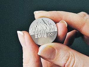 Новая 25-рублевка размером примерно как монета в 2 рубля.