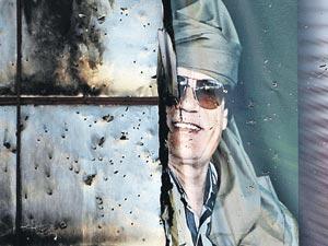 Призрак Муамара Каддафи еще долго будет взирать на новую Ливию - свободную, но разграбленную.