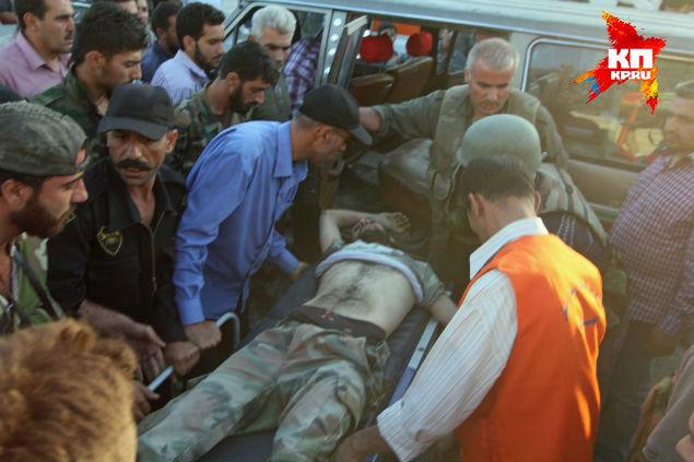 Раненый солдат под Маалюлей.