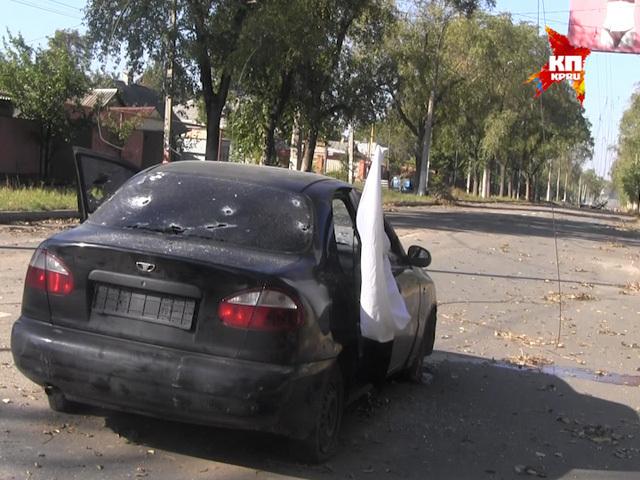 В Донецке украинская хунта расстреляла машину с мирными переговорщиками